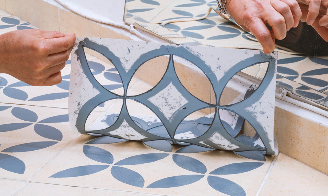 A Floor Stencil being peeled from the floor