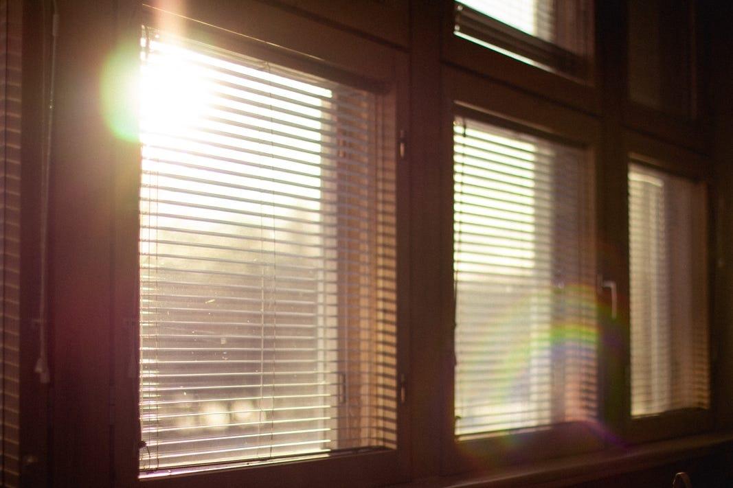 Sun shining on blinded windows