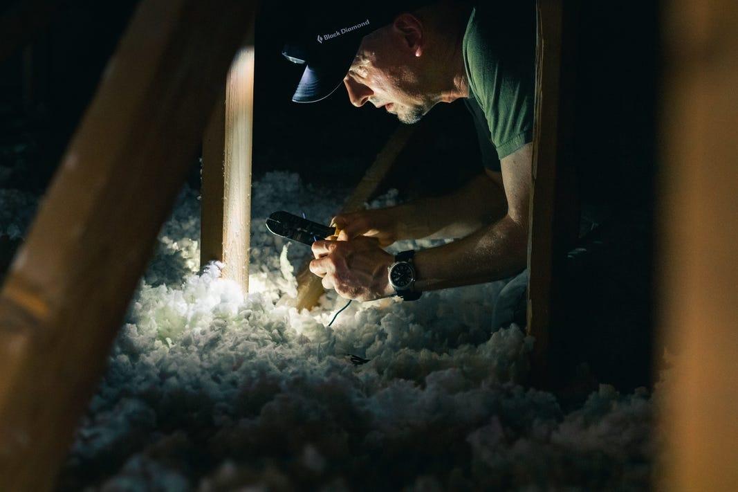 Man working in attic